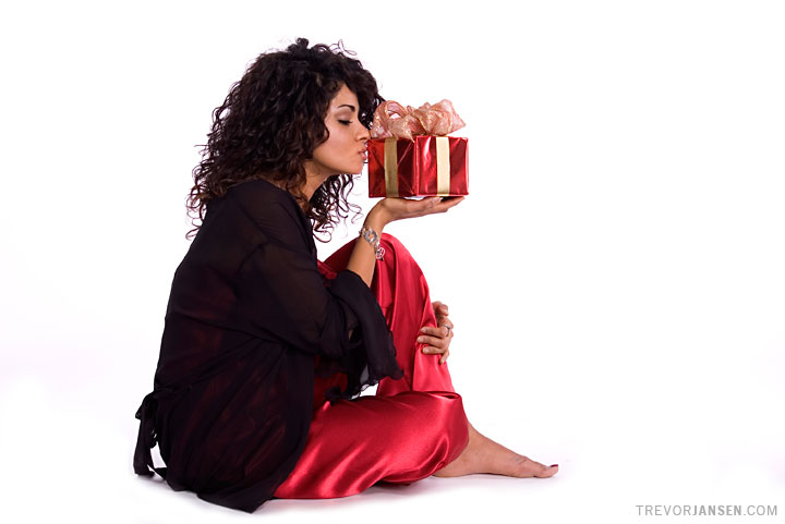 Christmas portrait of Zara Durrani holding a gift