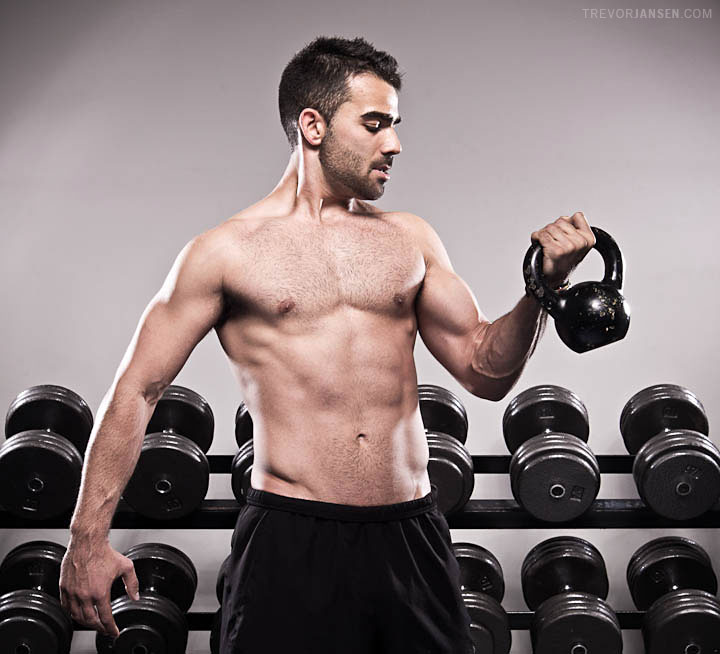 West Coast Fitness trainer Francis dos Santos lifting kettle bells