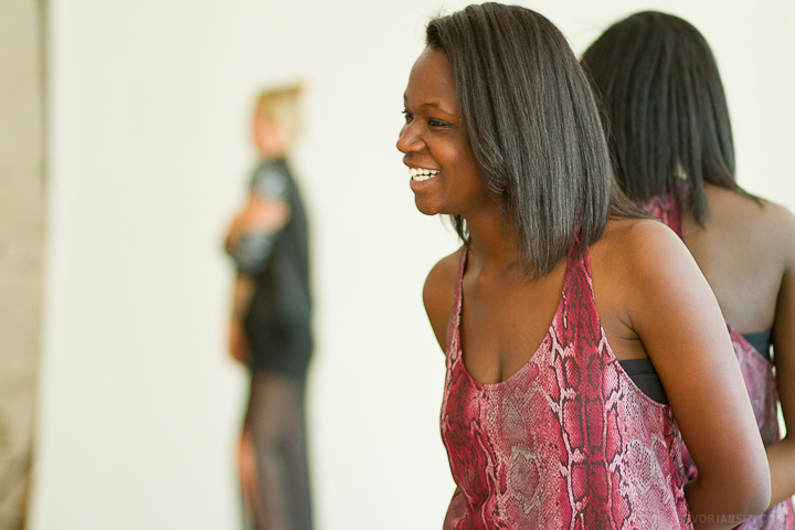 A model laughing behind the scenes at a photo shoot