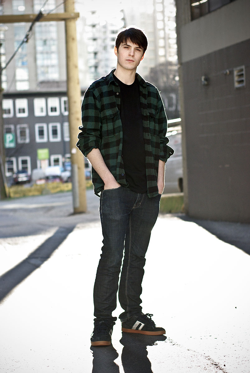 Outdoor portrait of a young man in an alley