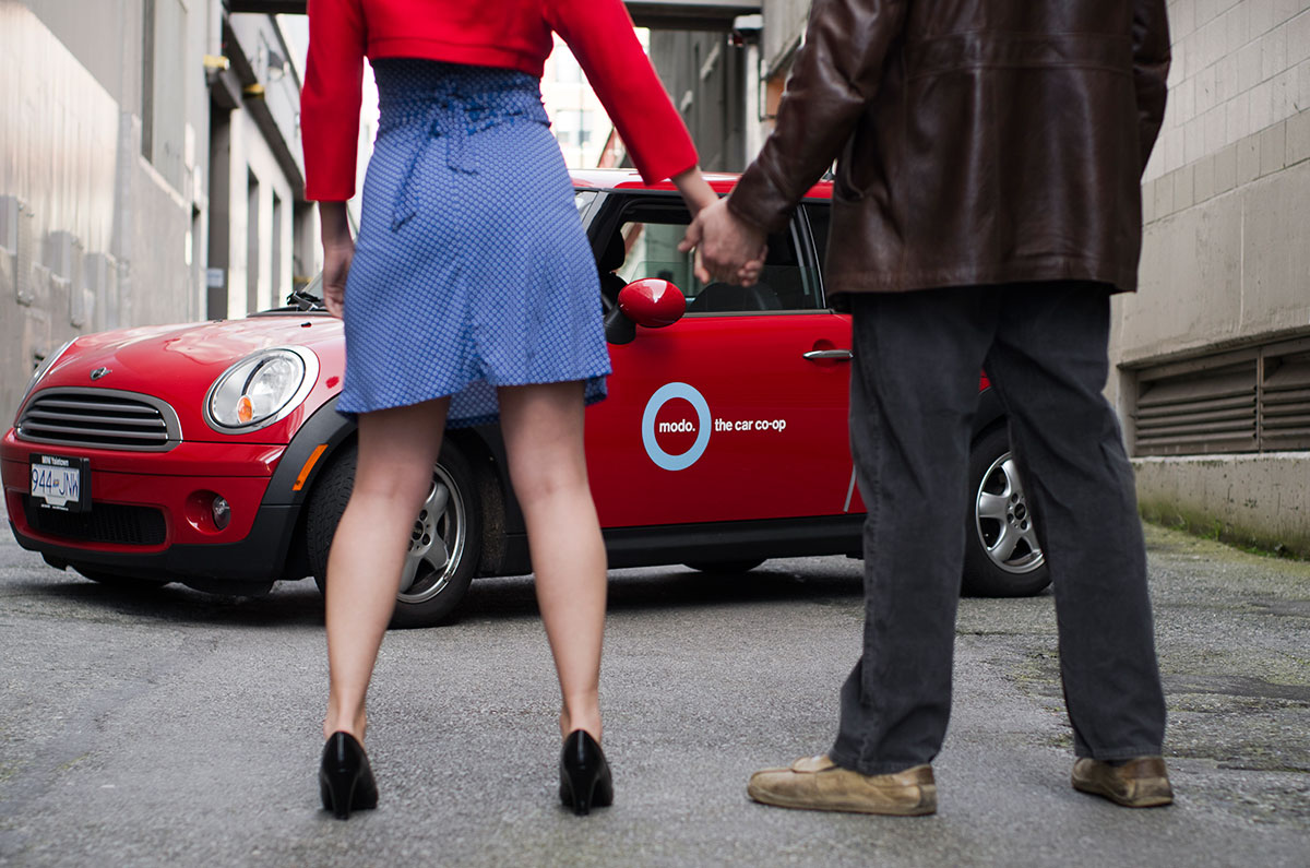 Modo the Car Coop | Advertising Photography | A young couple stand in front of their rental vehicle