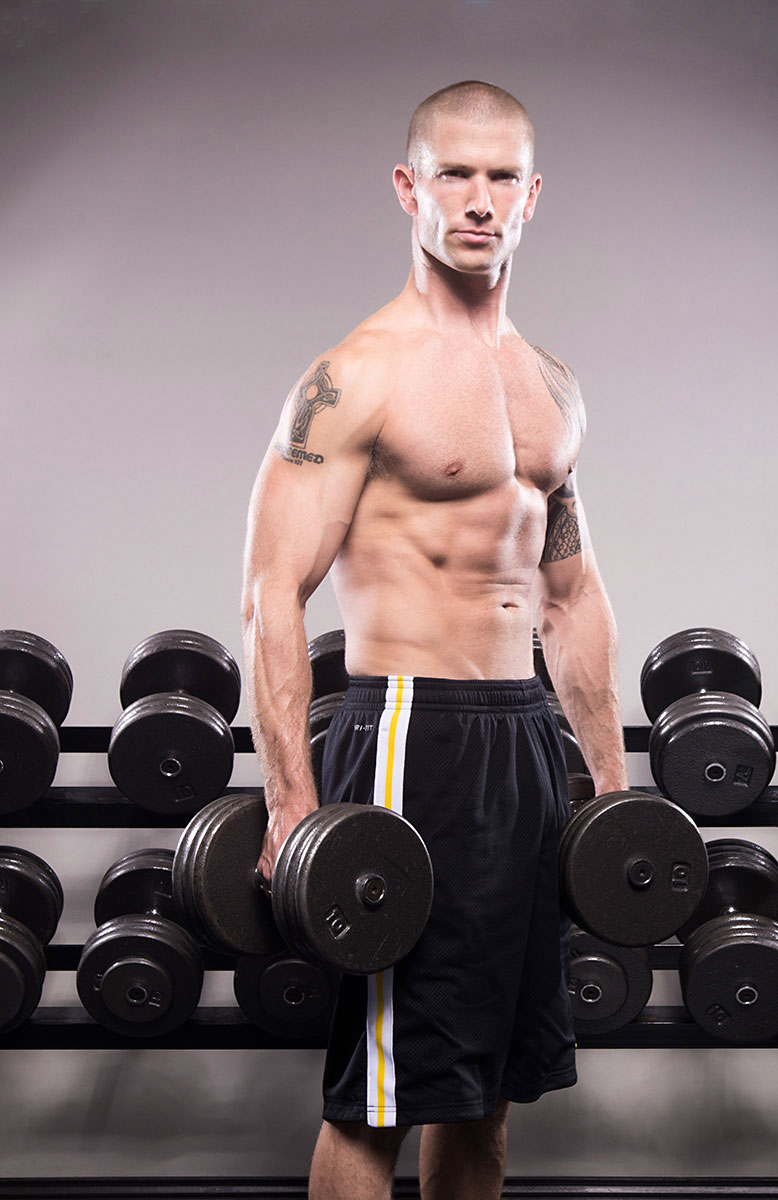 West Coast Fitness instructor demonstrates with dumbbells | Commercial Photography