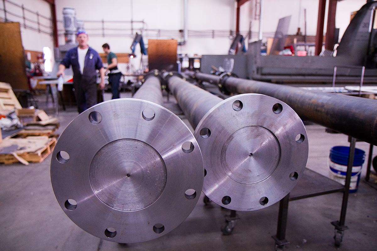 Commercial Photography for Dynamix Agitators Inc. | Engineers prepare impeller shafts