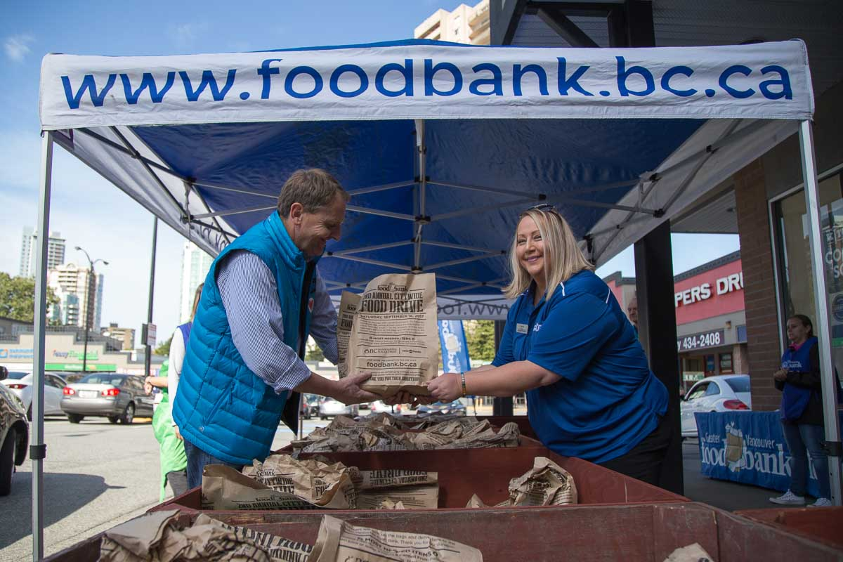 Foodbank Drive organizers accepting donations at event