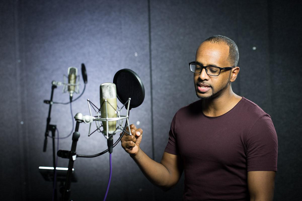 Environmental portrait of Amir Nasr in a recording studio