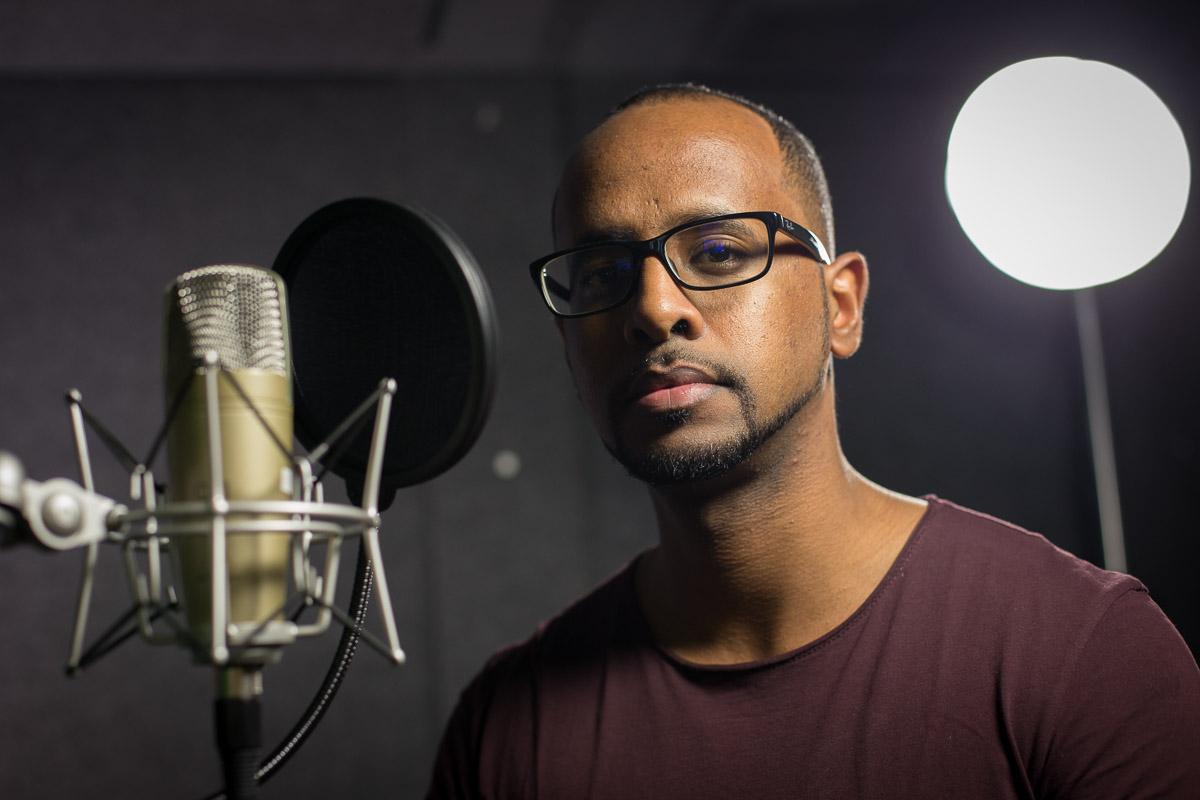 Character portrait of Amir Nasr in a recording studio