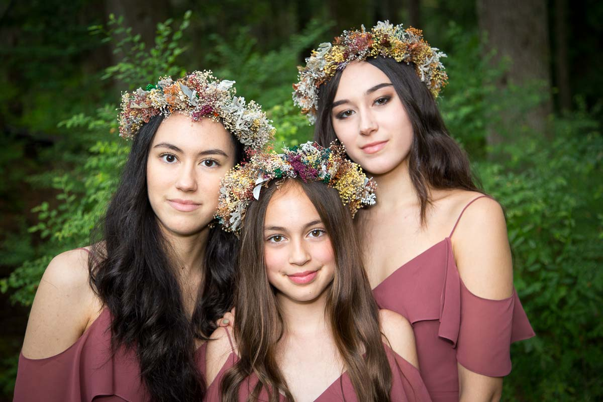 Portrait of three sisters in BC forest