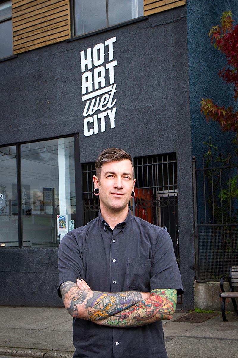 Editorial portrait of Chris Bentzen in front of his gallery Hot Art Wet City