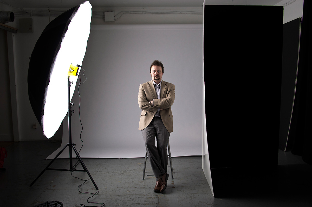 Kris Sigurdson sits for his portrait for an academic periodical